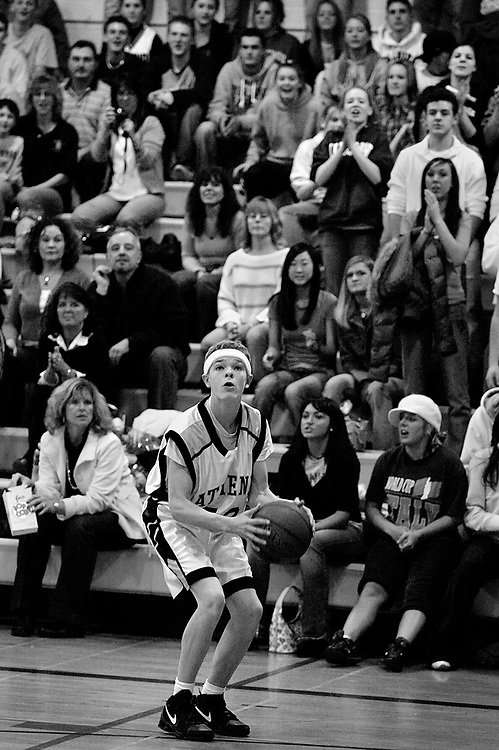 With his fans behind him, Jason launches another three-point field goal during the last few minutes of the fourth quarter.  Jason went on to hit six three-pointers, finishing the memorable night with a 20-point performance.