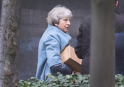 © Licensed to London News Pictures. 16/12/2019. London, UK. Former Prime Minister Theresa May carries a cardboard box as she arrives at Parliament. Parliament will sit tomorrow with newly elected MPs taking their seats ahead of the State Opening of Parliament on Thursday. Photo credit: Peter Macdiarmid/LNP