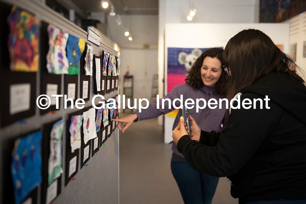 """Tasha Nez, GallupARTS Program Assistant, right, records a Facebook Live video of GallupARTS Executive Director Rose Eason Saturday, March 14 at Art123 Gallery for their 6th Annual Youth Art Show - """"Virtual Opening."""" The youth art show showcases 600 students from 14 different schools and 15 art teachers and will be on display at Art123 Gallery until April 7."""