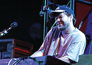 String Cheese Incident keyboardist Kyle Hollingsworth smiles while playing the keys in Birmingham on Thursday. / Elliot Knight