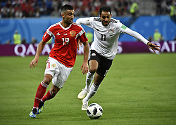 SAINT PETERSBURG, June 19, 2018  Alexandr Samedov (L) of Russia vies with Kahraba of Egypt during a Group A match between Russia and Egypt at the 2018 FIFA World Cup in Saint Petersburg, Russia, June 19, 2018. Russia won 3-1. (Credit Image: © Chen Yichen/Xinhua via ZUMA Wire)