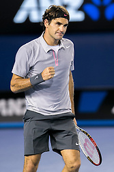 © Licensed to London News Pictures. 25/01/2013. Melbourne Park, Australia. Roger Federer clenches his fist in celebration after winning a point during the Mens Semi Final between Andy Murray Vs Roger Federer of the Australian Open. Photo credit : Asanka Brendon Ratnayake/LNP