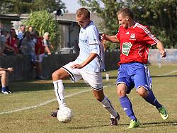 FODBOLD: Nicklas Jonassen (Helsingør) trækker sig fri under kampen i Danmarksserien, pulje 1, mellem Døllefjelde-Musse IF og Elite 3000 Helsingør den 23. august 2009 på Døllefjelde Stadion. Foto: Claus Birch