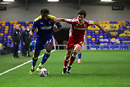 AFC Wimbledon defender Darnell Johnson (27) dribbling and battles for possession during the EFL Sky Bet League 1 match between AFC Wimbledon and Gillingham at Plough Lane, London, United Kingdom on 23 February 2021.