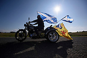A Scottish Independence Campaigner takes to his motorbike decked out in Scottish flags on the last day of campaigner before the vote took place in 2014