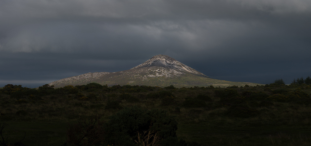The Sugarloaf Mountain, near Bray, Co.Wicklow. The setting sun lights up the west side of the mountain with the foreground already in shadow.<br /> Just enough time to capture this panorama, all in shadow within a couple of minutes.