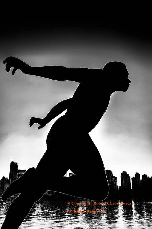 Runner for All Time (B&W): With a backdrop of the ocean and a city sky line as a silhouette; the world champion runner, Harry Winston Jerome, is immortalized by this splendid work of art for all time, Stanley Park, Vancouver British Columbia Canada.