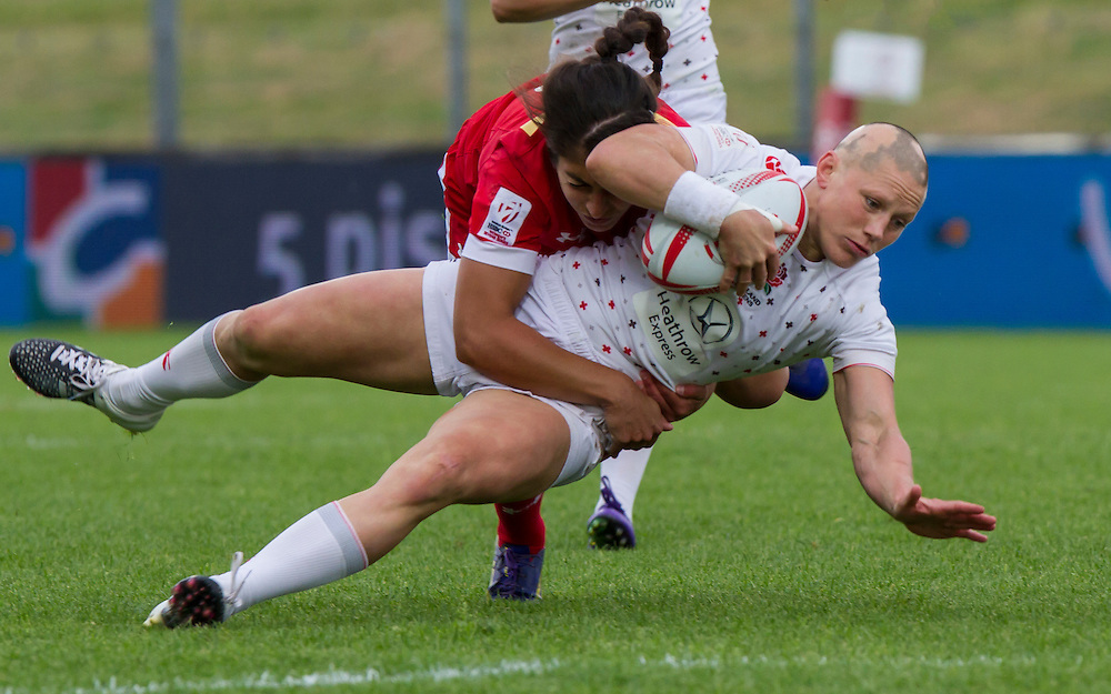 Heather Fisher tackled by Bianca Farella, World Rugby Women's HSBC Sevens Series, Clermont Ferrand, Day 2, at Stade Gabriel Montpied, Clermont Ferrand, France, on 29th May 2016