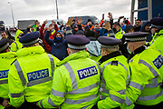 The Police line as tensions are high between police and drivers who have been waiting over 48 hours for the Port of Dover to re-open, on the 23rd of December 2020, Dover, Kent, United Kingdom. The French border was closed due to a new strain of COVID-19 all travellers are now waiting to receive a COVID-19 test before they can board a ferry to Calais, France. Dover is the nearest port to France with just 34 kilometres (21 miles) between them. It is one of the busiest ports in the world. As well as freight container ships it is also the main port for P&O and DFDS Seaways ferries.  (photo by Andrew Aitchison / In pictures via Getty Images)