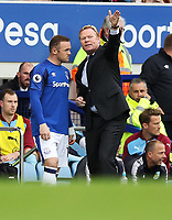 Football - 2017 / 2018 Premier League - Everton vs. Burnley<br /> <br /> Everton manager Ronald Koeman gives instructions to Wayne Rooney of Everton at Goodison Park.