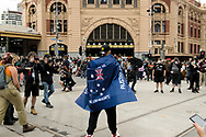 A member of the Far Right Proud Boys walks into the middle of the Invasion Day protest outside of Flinders Street Station during a march through the city of Aboriginal people and their supporters in Melbourne on Australia Day (which they called, 'Invasion Day'). Australia marks the anniversary of the arrival of the First White Settlers in Australia. (Photo by Michael Currie/Speed Media)