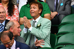 © Licensed to London News Pictures. 04/07/2016. SIR CLIFF RICHARD watches tennis on the centre court on the seventh day of the WIMBLEDON Lawn Tennis Championships. London, UK. Photo credit: Ray Tang/LNP