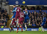 Football - 2019 / 2020 Premier League - Chelsea vs. West Ham United<br /> <br /> Fabian Balbuena (West Ham United) rises high to clear the ball as Chelsea pile on the pressure in search of the equaliser at Stamford Bridge <br /> <br /> COLORSPORT/DANIEL BEARHAM