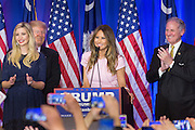 Melina Trump, wife of billionaire and GOP presidential candidate Donald Trump address supporters during victory celebrations following their win in the South Carolina Republican primary February 20, 2016 in Spartanburg, South Carolina, USA. (L-R): Ivanka Trump, Donald Trump, Melinia Trump & Lt. Gov. Henry McMasters.