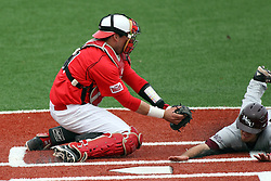 06 April 2013:  Catcher Mike Hollenbeck put the out tag on Joey Hawkins as Hawkins slides to the plate during an NCAA division 1 Missouri Valley Conference (MVC) Baseball game between the Missouri State Bears and the Illinois State Redbirds in Duffy Bass Field, Normal IL