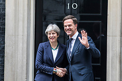 © Licensed to London News Pictures. 21/02/2018. London, UK. Prime Minister Theresa May (L) and Dutch Prime Minister Mark Rutte (R) shake hands on the doorstep of 10 Downing Street. Photo credit: Rob Pinney/LNP