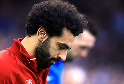 Liverpool's Mohamed Salah walks out before the match