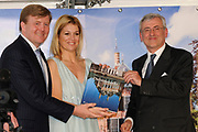 The Dutch prince Willem-Alexander (R) and his wife princess Maxima walk in front of Castle Duivenvoorde in Voorschoten, The Netherlands on 28 April 2010. The royal couple opened the exhibit Tijdloos Trendy (Forever Trendy). The exhibit is one of the activities of the 50th anniversary of the Duivenvoorde foundation. <br /> <br /> On the Photo:  Boekoverhandiging