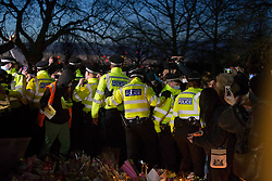 © Licensed to London News Pictures.13/03/2021. London,UK. Despite the official cancellation of the Reclaim These Streets vigil this evening. Members of the public gather to tribute for Sarah Everard at the band stand in Clapham Common, south London. Serving police constable Wayne Couzens, 48, appeared at Westminster Magistrates Court today and has been charged with with the kidnap and murder of Sarah Everard. Photo credit: Marcin Nowak/LNP