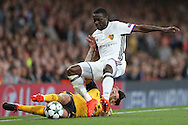 Hector Bellerin of Arsenal and Adama Traore of FC Basel collide as they compete for the ball. UEFA Champions league group A match, Arsenal v FC Basel at the Emirates Stadium in London on Wednesday 28th September 2016.<br /> pic by John Patrick Fletcher, Andrew Orchard sports photography.