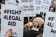 Hundreds of lawyers and barristers staged a protest at Westminster against legal aid cuts. They carried with them a huge effigy of Chris Grayling, the Justice Minister and were led by 'Justice' in a gold costume.<br /> <br /> Speakers included - Sadiq Khan is the Labour MP for Tooting and shadow minister for London, Shami Chakrabarti Director of Liberty, Blur drummer-turned-solicitor Dave Rowntree and Paddy Hill, one of the Birmingham Six.  Houses of Parliament, Westminster, London, UK 07 March 2014.<br /> Guy Bell, 07771 786236, guy@gbphotos.com