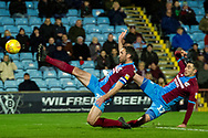 Scunthorpe United defender Rory McArdle (23) & Scunthorpe United forward Lee Novak (17) stretch out for a touch on the ball to try and score a goal during the EFL Sky Bet League 1 match between Scunthorpe United and Wycombe Wanderers at Glanford Park, Scunthorpe, England on 29 December 2018.
