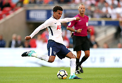 Tottenham Hotspur's Dele Alli has a shot on target during the pre-season friendly match at Wembley Stadium, London.