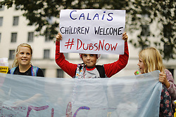 © Licensed to London News Pictures. 15/10/2016. London, UK. Pro-refugee protesters demand the Goverment to enact Lord Dubs amendment to take more children refugees to Britain at Parliament Square, London on 15 October 2016. Photo credit: Tolga Akmen/LNP
