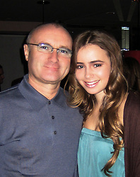 EXCLUSIVE. NO TABLOIDS. File pictures of British Lily Collins, 18, with her parents Phil Collins and Jill Tavelman. She will make her debut at the 17th Paris Crillon Ball, to be held at the Hotel de Crillon in Paris, next November 24. She will be wearing a Chanel dress. Photo Courtesy Collins's Family via ABACAPRESS.COM Mandatory Credit : Crillon Ball, adler jeweller, Make-up by MAC | 129808_21