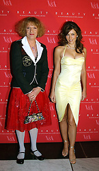 Left to right, artist GRAYSON PERRY and LIZ HURLEY wearing a Versace dress and Jimmy Choo shoesat a party to launch 'Beauty Week' at the V&A in association with Estee Lauder- a special week of debates, talks and performances celebrating beauty on 24th January 2005.<br />