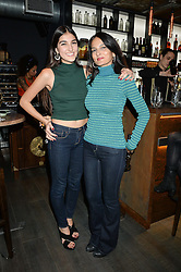 Left to right, LAUREN MILLS and YASMIN MILLS at the launch of Korean restaurant Jinjuu with chef Judy Joo at 15 Kingley Street, London on 22nd January 2015.