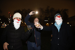 © Licensed to London News Pictures. 31/12/2020. London, UK. Brexit supporters celebrate at 11PM UK time, 12 midnight in Brussels, as the transition period ends and the UK has finally left the EU on a muted New Year's Eve in central London. Photo credit: Peter Macdiarmid/LNP