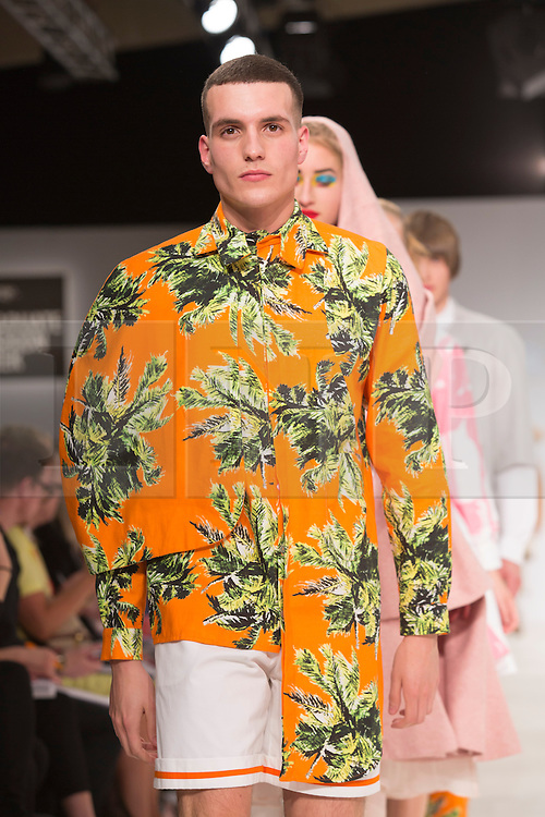 © Licensed to London News Pictures. 30/05/2015. London, UK. A model walks the runway during the Birmingham City University fashion show at Graduate Fashion Week 2015 wearing the collection of graduate student Kiran Kang. Graduate Fashion Week takes place from 30 May to 2 June 2015 at the Old Truman Brewery, Brick Lane. Photo credit : Bettina Strenske/LNP