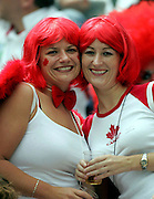 Canadian Sevens fans enjoy the rugby at the 2005 Rugby World Cup Sevens, Hong Kong, Saturday 19 March 2005. <br />PHOTO: Andrew Cornaga/PHOTOSPORT
