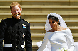 Prince Harry and Meghan Markle walk down the steps of St George's Chapel in Windsor Castle after their wedding.