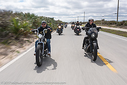 Bryan Lane (L) of Waxhaw, NC riding his custom 1947 custom Harley-Davidson Knucklehead bobber alongside Iron Lilly Kristen Lassen on a 2014 Harley-Davidson Iron 883 Sportster<br /> on A1A near Flagler Beach during Daytona Beach Bike Week. FL. USA. Tuesday, March 14, 2017. Photography ©2017 Michael Lichter.