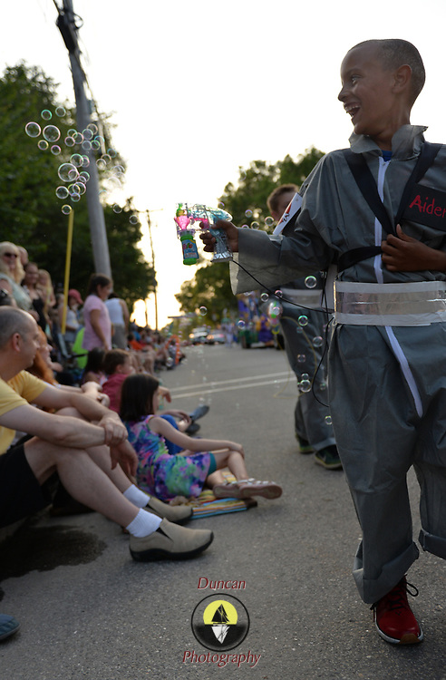 YARMOUTH, Maine --  7/21/17 --   Ghostbuster Aiden Brooks, 10, of Yarmouth shoots bubbles at the parade onlookers at the Yarmouth Clam Festival Parade on Friday. The annual celebration of seafood drew thousands of visitors from around the region. Photo by Roger S. Duncan for the Forecaster