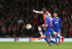 Nicolas Pepe of Arsenal and Mathieu Valbuena of Olympiacos tussle for the ball - Mandatory by-line: Arron Gent/JMP - 27/02/2020 - FOOTBALL - Emirates Stadium - London, England - Arsenal v Olympiacos - UEFA Europa League Round of 32 second leg