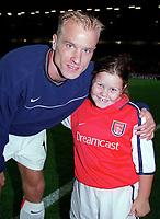 Dennis Bergkamp with the Arsenal mascot. Arsenal 2:0 Lazio, Highbury Stadium, UEFA Champions League, Group B, 27/9/2000. Credit Colorsport / Stuart MacFarlane.