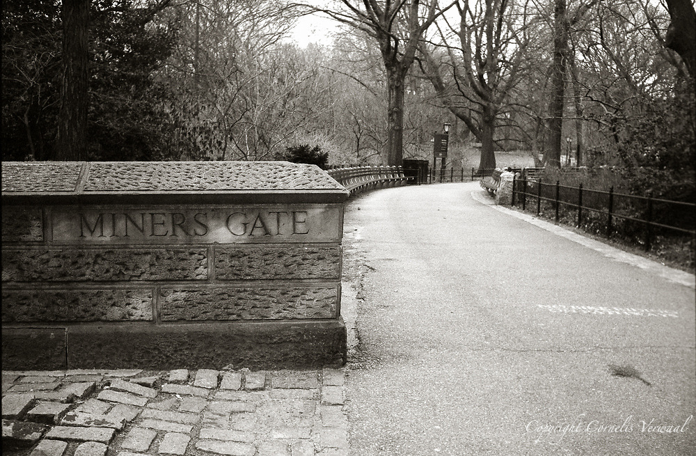 Miners Gate into Central Park, New York, 2008.<br /> Olympus Trip 35, Zuiko 40mm f2.8, Fuji Superia 400, converted to BW and toned.