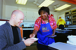 Its Rosti Tasting time for the customers of  Asda at Handsworth in Sheffield as the McCaine roadshow rolled into town on Tuesday morning Oct 11 2001 with celebrity cook Rusty Lee providing some demostrations