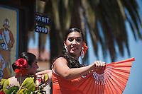 Woman in traditional spanish dress in Fiesta parade, Santa Barbara, California, USA