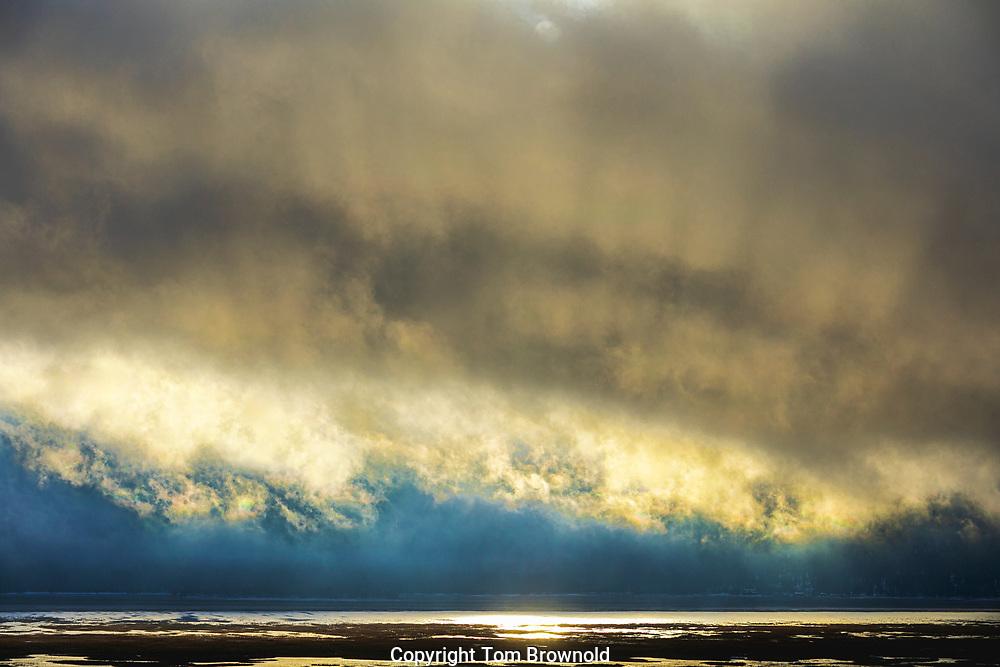 snow squall crossing Mormon lake, AZ at sun set
