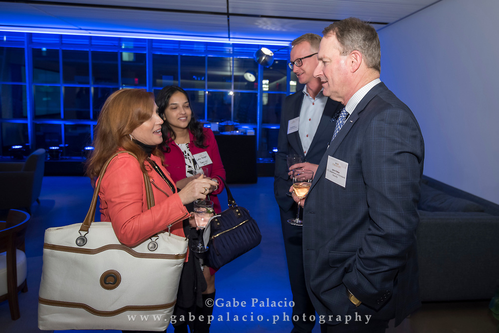 Networking at The WSJpro Cybersecurity event  in New York City on December 12, 2017. (photo by Gabe Palacio)