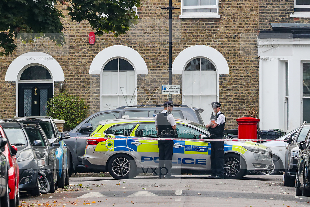 Police continue to guard a crime scene in Stockwell Road, Lambeth in South London waiting for forensic units on Wednesday, Sept 16, 2020 - after a man, aged 20, was stabbed to death in the previous day. (VXP Photo/ Vudi Xhymshiti)