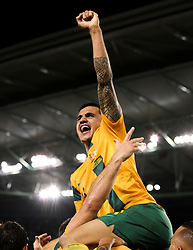 © Licensed to London News Pictures. 11/6/2013. Tim Cahill jumps on top of his teammates in celebration  during the FIFA World Cup Qualifying match between Australia Vs Jordan at Docklands stadium, Melbourne, Australia.. Photo credit : Asanka Brendon Ratnayake/LNP