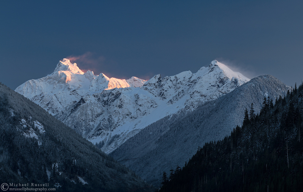 Snow blowing off of Nodoubt Peak during a late fall sunset.  Photographed from Chilliwack Provincial Park in Chilliwack, British Columbia, Canada.