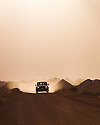 Offroad vehicle driving along a dirt road in Coober Pedy, South Australia, Australia