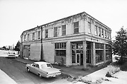 Y-680604-A20.  The Sadler & Kraus General Merchandise Store, located on 3rd, Main & 99E. In later years it was a second hand store and was destroyed by fire in 1990. Aurora, Oregon. June 4, 1968
