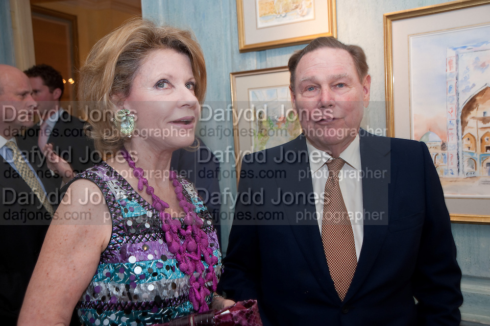 KATHARINE RAYNER; WILLIAM RAYNER, An exhibition of watercolours by William Rayner at Mallet's, New Bond St. Party afterwards at Bellami's, bruton Place. London. 16 June 2010. .-DO NOT ARCHIVE-© Copyright Photograph by Dafydd Jones. 248 Clapham Rd. London SW9 0PZ. Tel 0207 820 0771. www.dafjones.com.